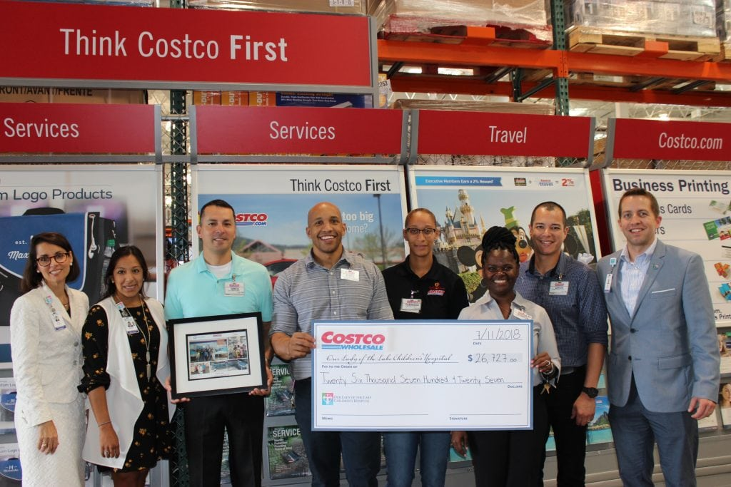 Ericka Garcia Childrens Miracle Network Specialist Greg Brenner Costcos General Manager Brian Tarissa Sharon And David Costco Employees