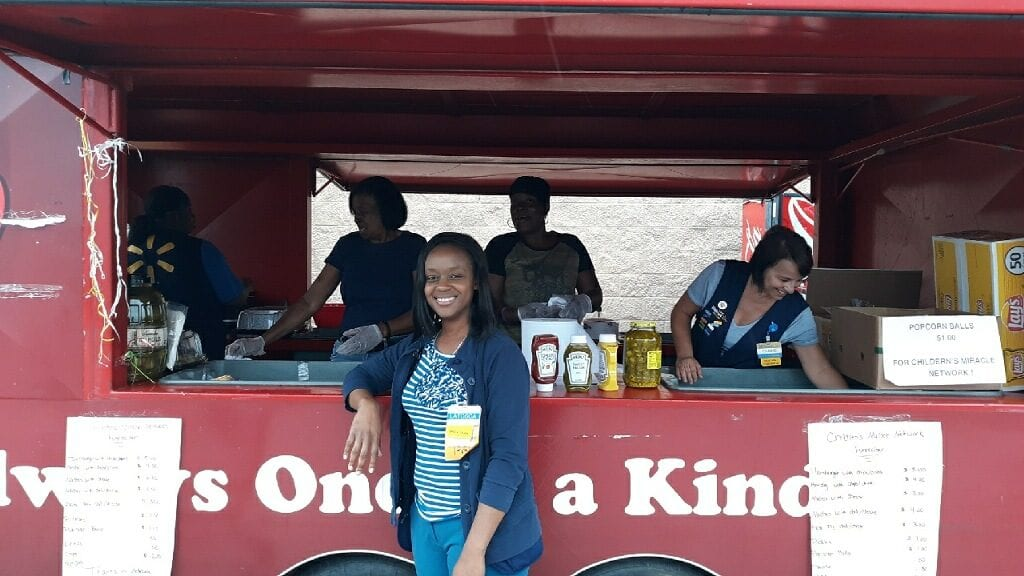 Associates from Walmart 401 in Plaquemine host a food truck with assistance from their partner, Coca-Cola